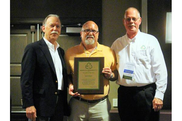 Interface wins CARE's 2016 Recycler of the Year. Bob Peoples, Eric Nelson and Brendan McSheehy