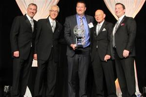 Carpetland USA Retailer of the Year - Eric Langan. L to R: Ryan Dunn (CarpetsPlus COLORTILE), Ron Dunn (CarpetsPlus COLORTILE), Eric Langan (The Langan Group), Jon Logue (CarpetsPlus COLORTILE) and Kevin Logue (CarpetsPlus COLORTILE)