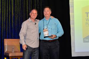 Jay Smith presents the Home Solutions Member of the Year Award to Mike James, Metro Carpets.