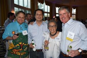 Lane Brettschneider and Umerto Aponte (Lane's Floor Covering), Peggy Weis (RD Weis) and Jack Ganley (Mannington)