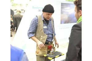 Domotex Magician entertains show attendees