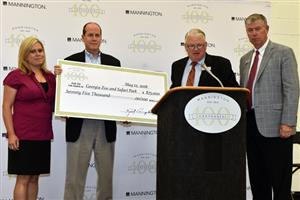 Mannington Mills presents $75,000 check to Georgia Zoo and Safari Park
