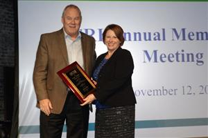 Milliken president Jim McCallum presented Susan Rich Farris with the Joseph j. Smrekar Memorial Award.