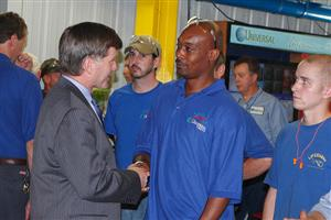 Gov. McDonnell with employee Michael Badgett