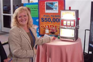 Rebecca Greer, cash in slot machine winner.