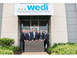 Shower Panel System Wedi Cuts Ribbon on Factory in Batavia, IL